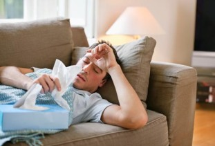 getty_rf_photo_of_sick_man_on_couch